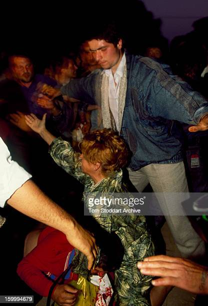 Woman tries to protect her husband, a government supporter, as he is attacked by an anti-Government crowd in Bucharest, Romania. Months of unrest...