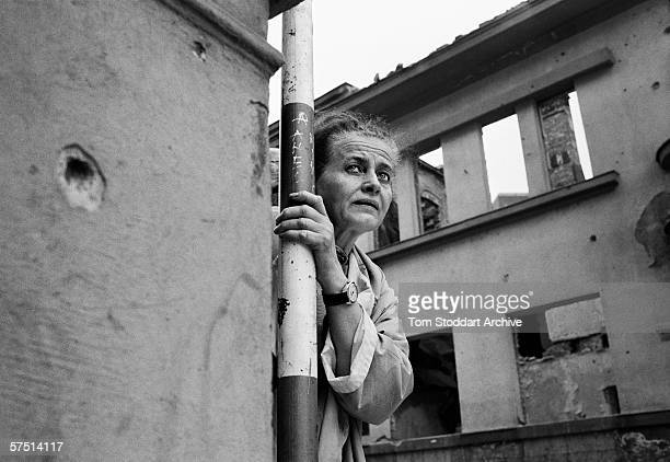 Woman tries to summon up the courage to run across 'Sniper Alley' during fighting in Sarajevo in 1994.