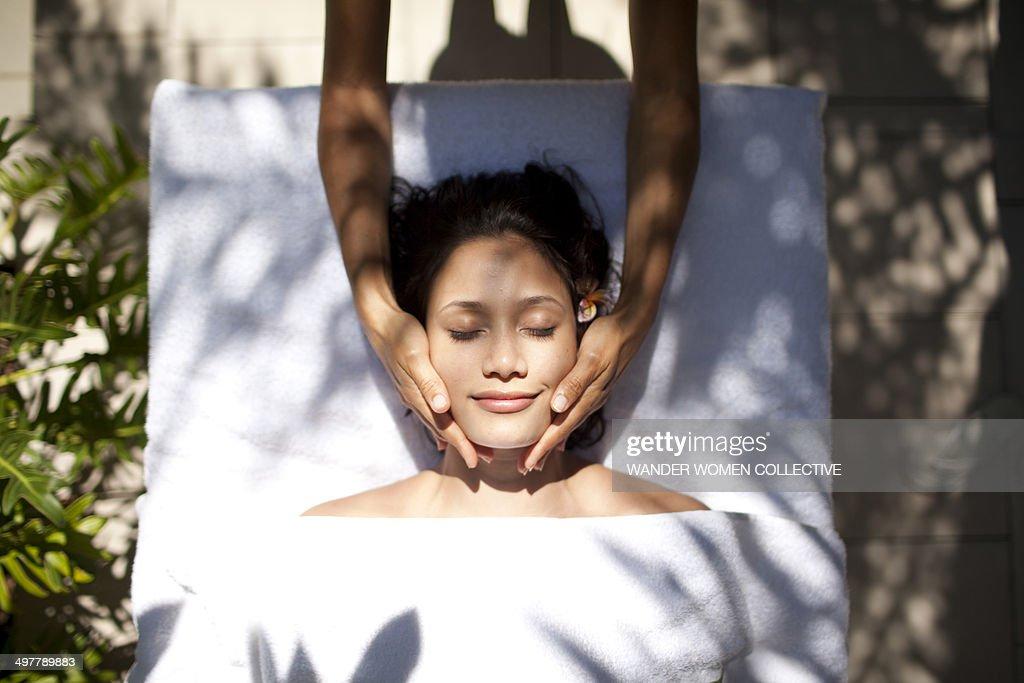 Woman tropical massage facial beauty treatment : Stock Photo