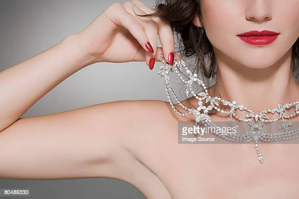 woman trying on a diamond necklace - necklace stock pictures, royalty-free photos & images
