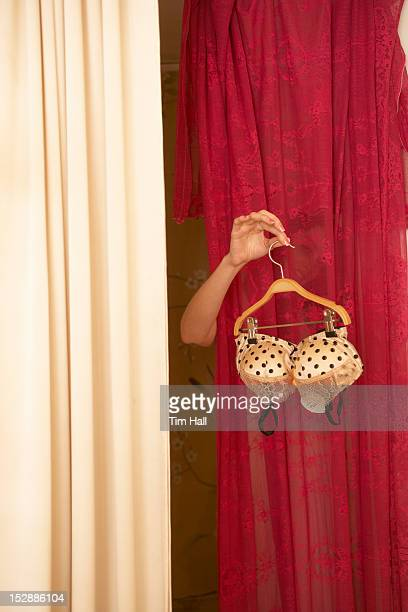 woman trying on bra in store - bras stock pictures, royalty-free photos & images