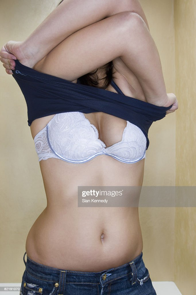 Woman trying on clothing : Stock Photo