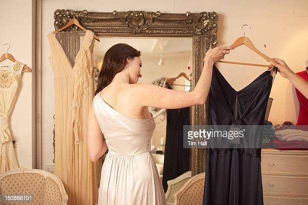 Woman trying on dress in store