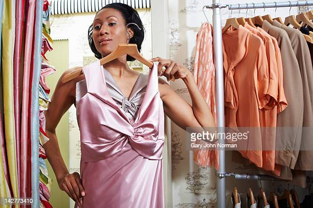 woman trying on dresses in boutique shop - evening gown stock pictures, royalty-free photos & images