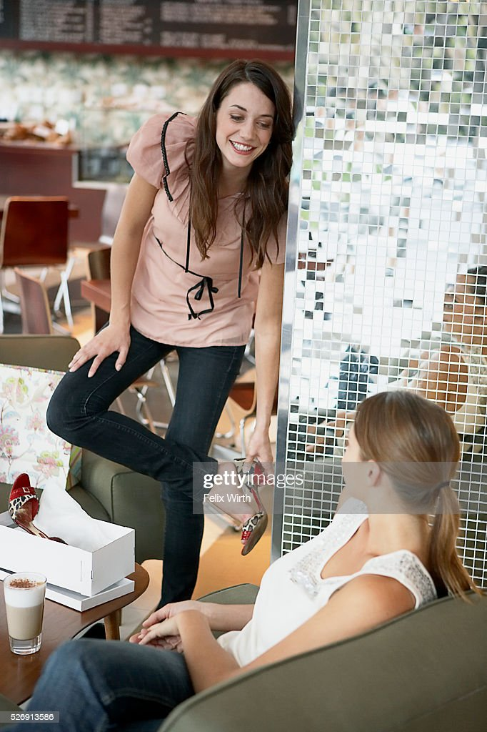 Woman trying on high heel shoe : Stock Photo