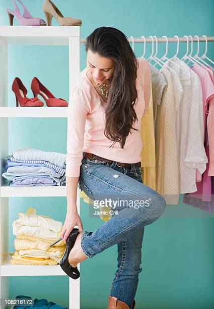 Woman trying on high heels at store