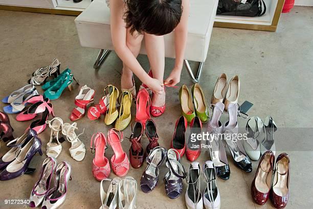 woman trying on high heels, high angle