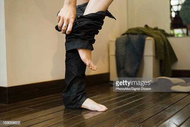 woman trying on jeans in fitting room - pants stock pictures, royalty-free photos & images