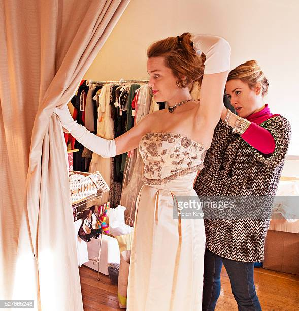 woman trying on necklace in vintage store - strapless evening gown stock pictures, royalty-free photos & images