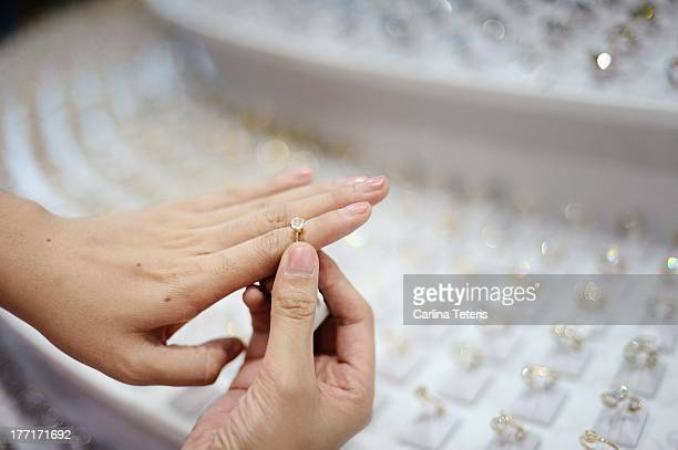 woman trying on rings - jewelry store stock pictures, royalty-free photos & images