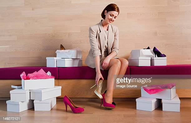 Woman trying on shoes in shoe shop