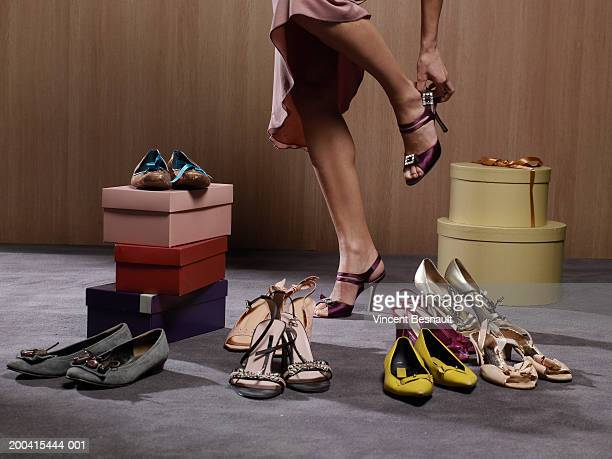 woman trying on shoes, low section - シューズボックス ストックフォトと画像