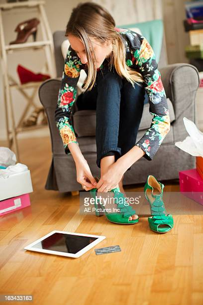 a woman trying on shoes - peep toe schuh stock-fotos und bilder