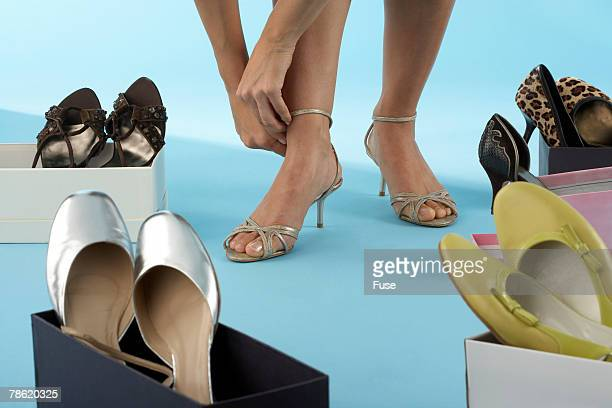 woman trying on shoes - gier stock-fotos und bilder