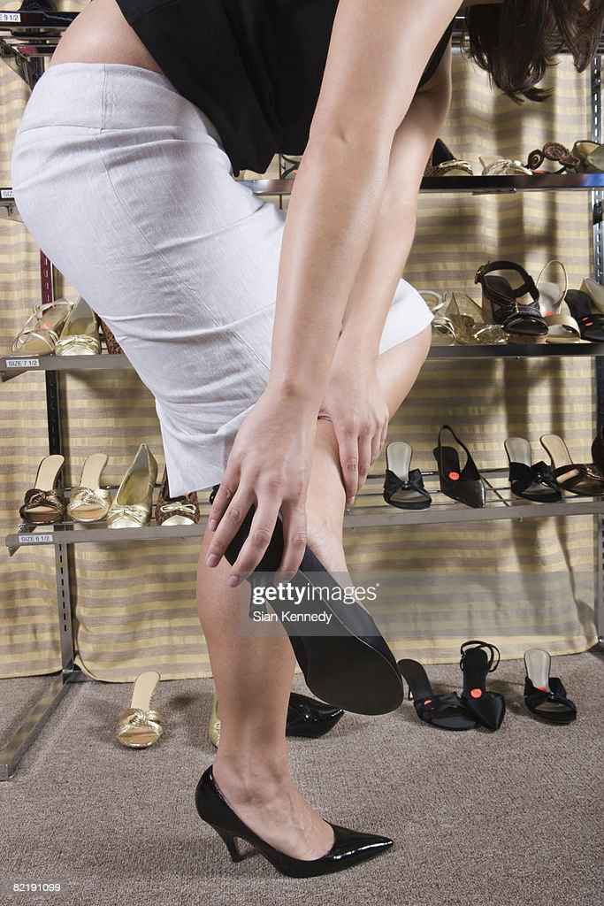 Woman trying on shoes : Stock Photo