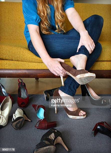 Woman trying on shoes.