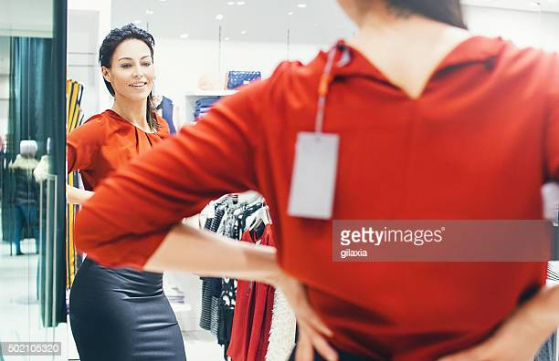 Woman trying on some clothes at a retail store.