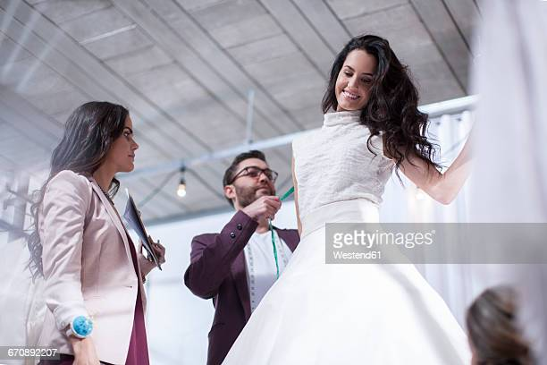 woman trying on wedding dress - wedding dress stock pictures, royalty-free photos & images