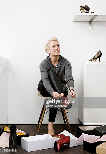 woman trying shoes in shoe store - stiletto stock pictures, royalty-free photos & images