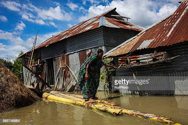 A woman trying to find out the damage of her house to due to flood water at Jamalpur Bangladesh Jamalpur is a northern district of Bangladesh...