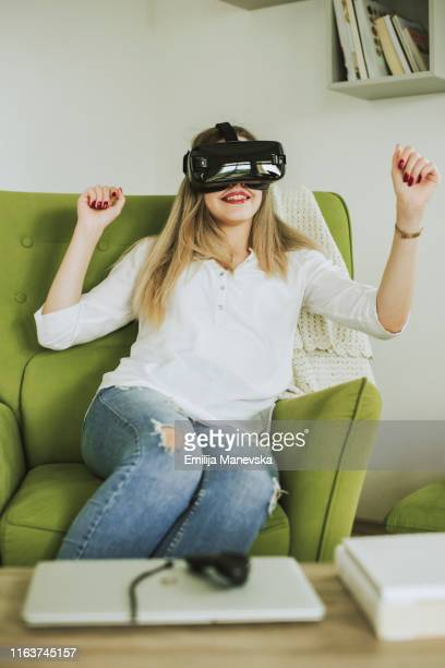 woman trying virtual reality simulator - gifted movie stock pictures, royalty-free photos & images