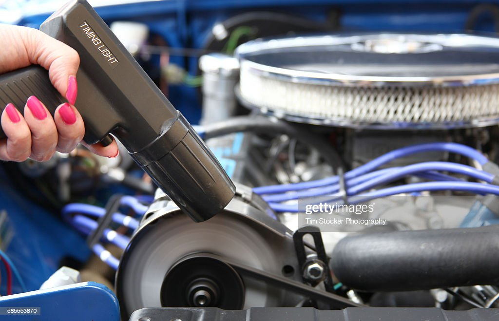 woman tuning  car engine   timing light stock photo getty images