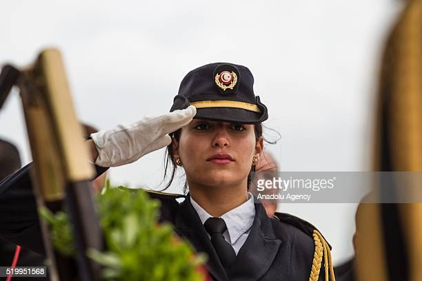 Woman Tunisian soldier makes a formal salute during the the 78th anniversary of Martyrs' Day commemoration at the Sijoumi martyrs' mausoleum in...