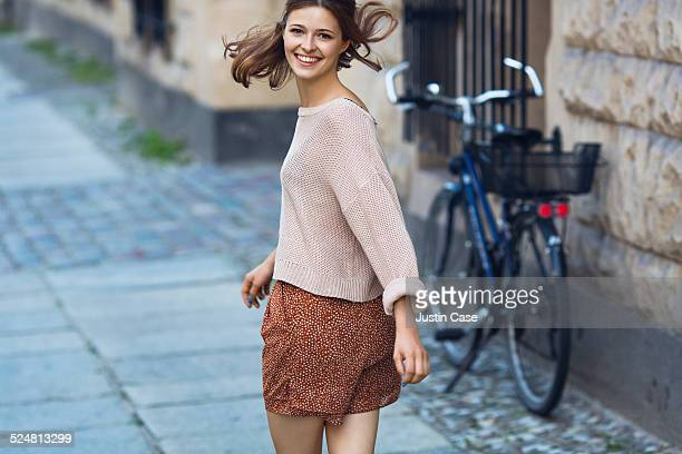 woman turning back and smiling towards camera