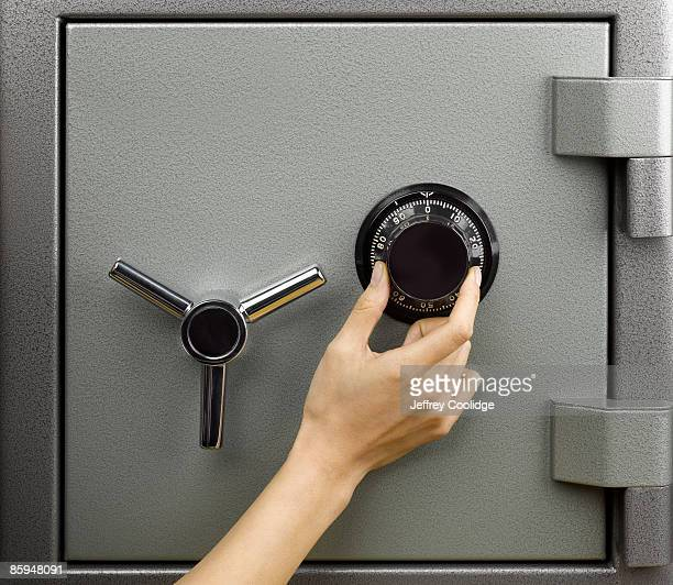 Woman turning Combination Dial on Safe