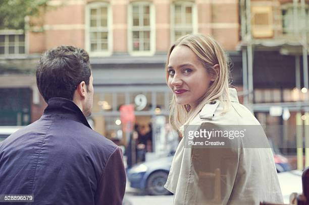 Woman turning to face camera