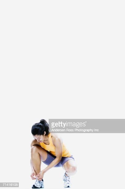 Woman tying sneaker