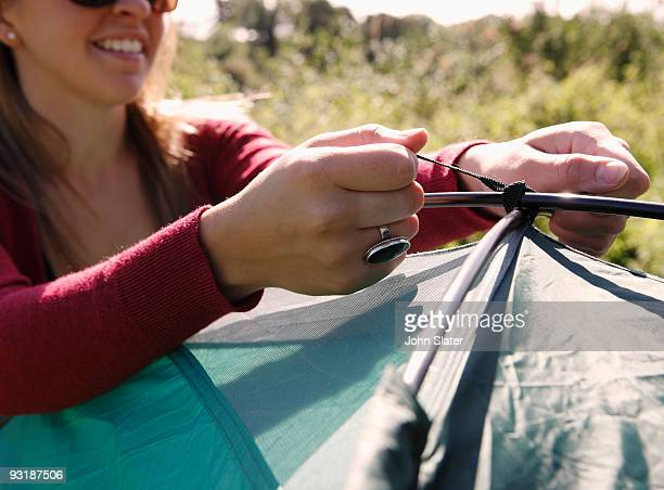 woman tying up top of tent
