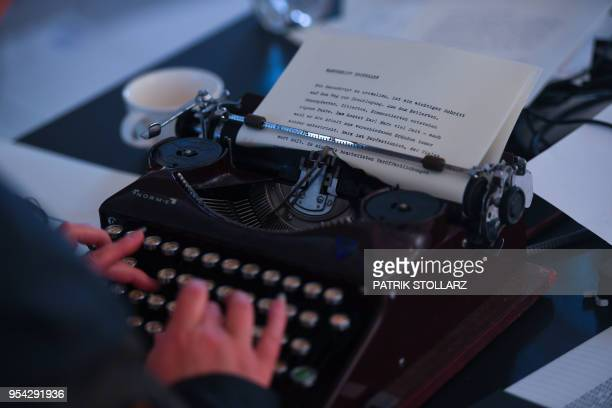 A woman types a text by German philosopher Karl Marx on a typewriter ahead of the opening of an exhibition exploring his works and life at his birth...