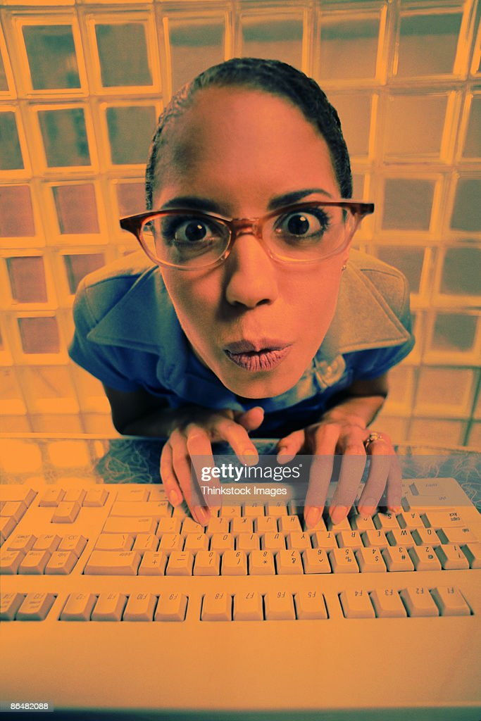 Woman typing on keyboard : Stock Photo