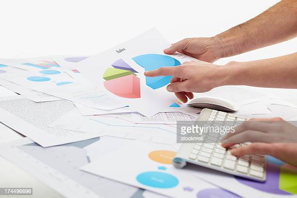 Woman typing on keybord with charts around her