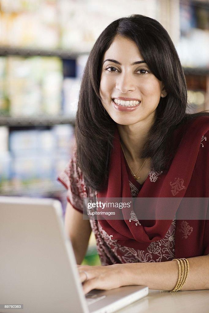 Woman typing on laptop : Stock Photo