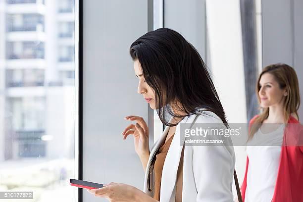 Woman typing on phone in Dubai