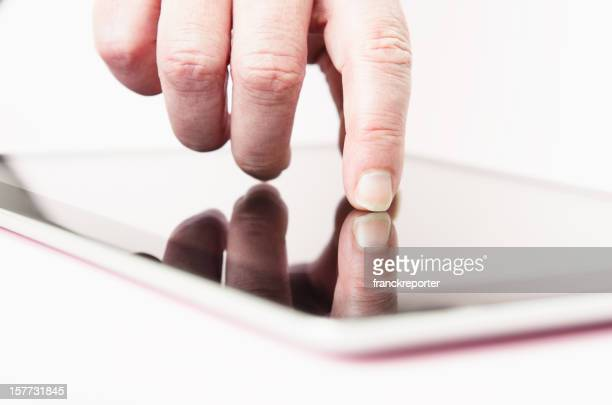 woman typing on touch screen of digital tablet