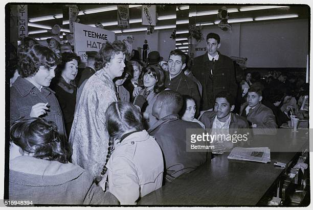 Woman unable to find a vacant seat at a F.W. Woolworth's lunch counter, chastises demonstrators participating in a sit down protest at the counter.