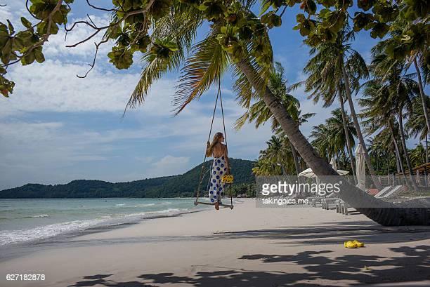 Woman under a palm