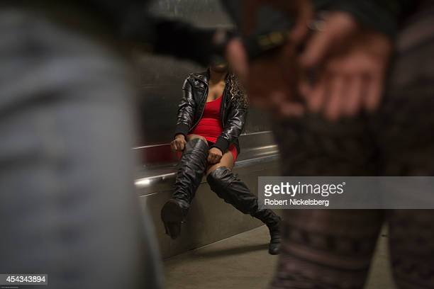 A woman under arrest waits in a holding cell February 1 2013 at the Los Angeles Police Department's South Central's 77th Street Division station on a...
