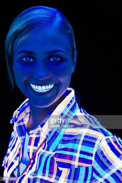 Woman under black lights, portrait