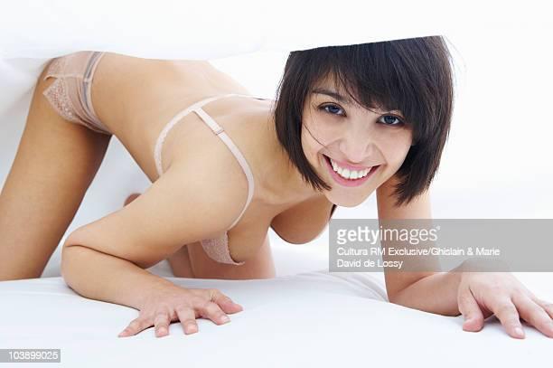 Woman under covers, in underwear