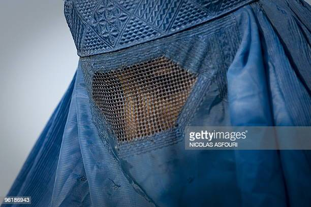 A woman under her burqa walks down a street in the old city of Kabul on November 1 2009 Abdullah announced on November 1 that he was pulling out of...