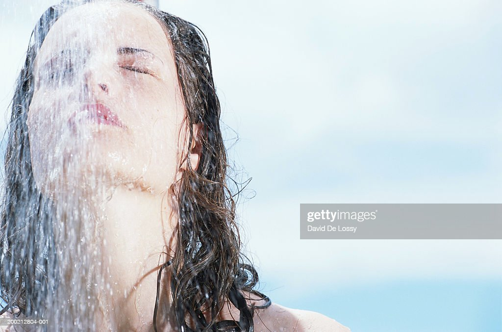 Woman under shower, outdoors : Stock Photo