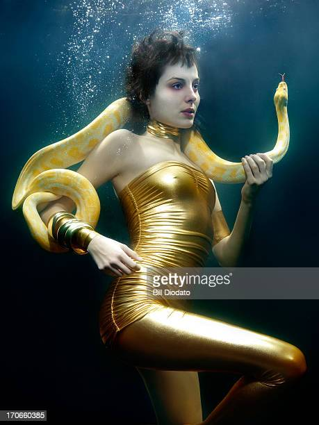 woman under water with snake