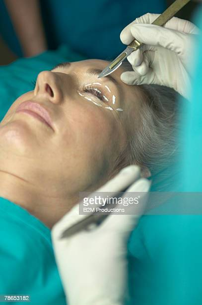 Woman undergoing eyelid surgery