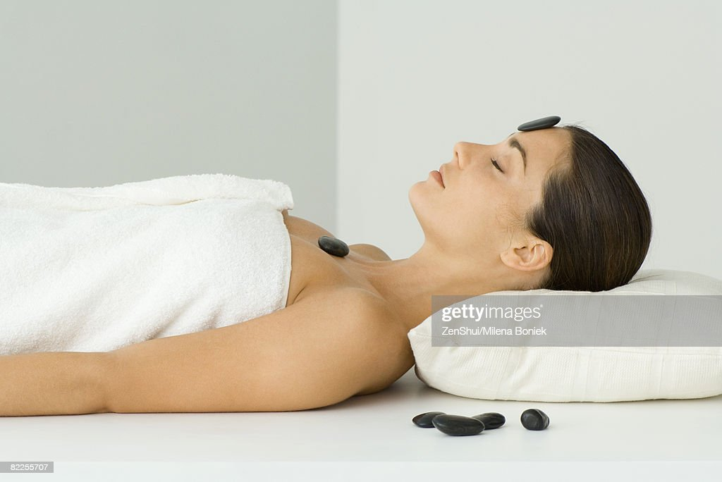 Woman undergoing lastone therapy, eyes closed : Stock Photo
