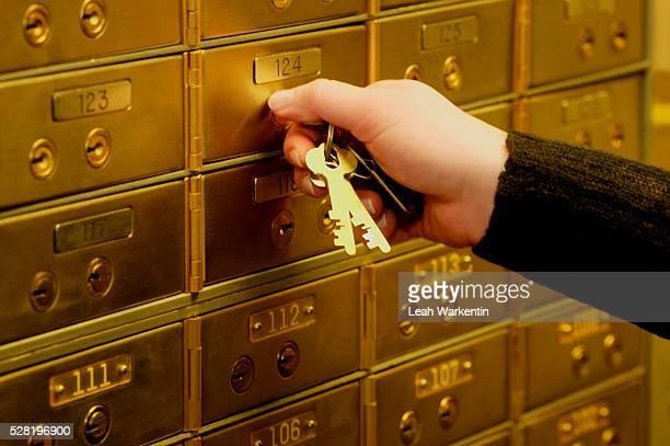Woman Unlocking Safe Deposit Box