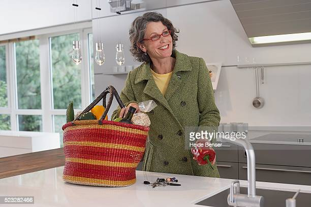Woman unpacking groceries